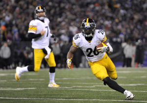 Pittsburgh Steelers running back Le'Veon Bell (26) runs toward the end zone as he tries to score a touchdown in front of quarterback Ben Roethlisberger in the second half of an NFL football game against the Baltimore Ravens, Thursday, Nov. 28, 2013, in Baltimore. Bell injured himself on the play and left the game. (AP Photo/Gail Burton)